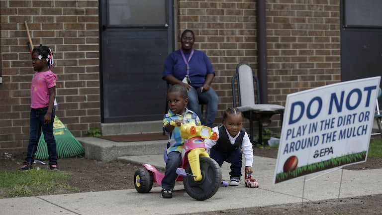 Children play at the West Calumet Housing Complex, which has been found to contain high levels of lead and arsenic.