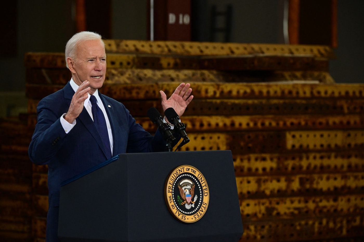 Joe Biden speaks at a podium.