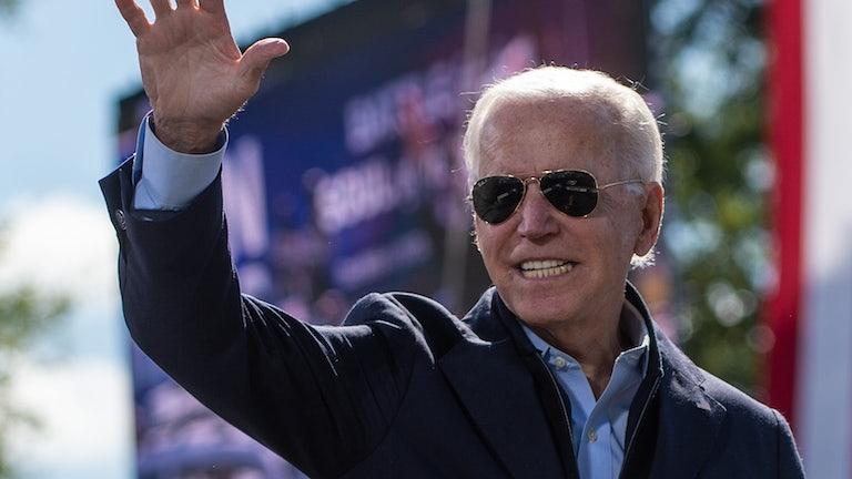 Joe Biden smiles at a campaign event