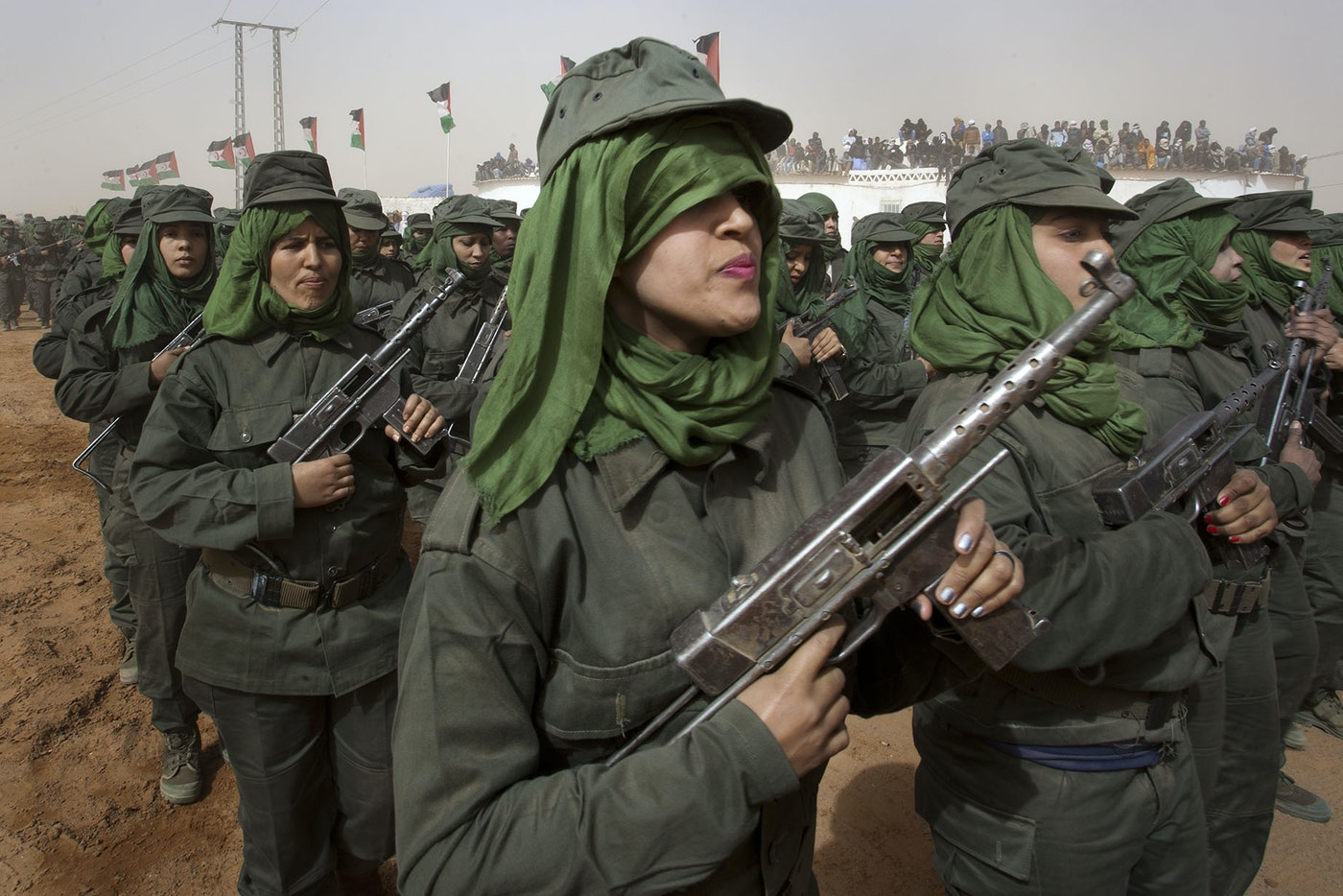 Five hundred Sahrawi women march in a military parade to commemorate the fortieth anniversary of Western Sahara's struggle for independence from neighboring Morocco.