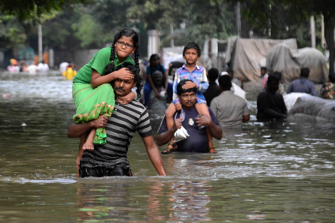 Chennai residents carry children through floodwaters in 2015.
