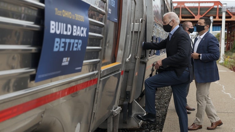 Joe Biden gets on an Amtrak train sporting his