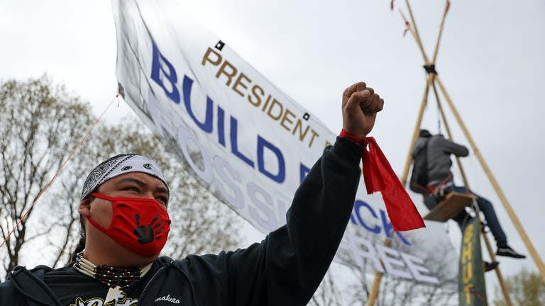 A protester holds a fist in the air.