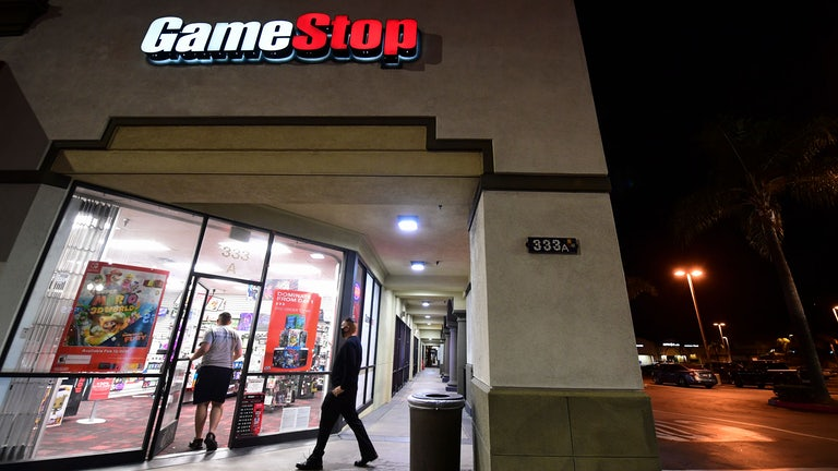 People enter a GameStop store in Alhambra, California.