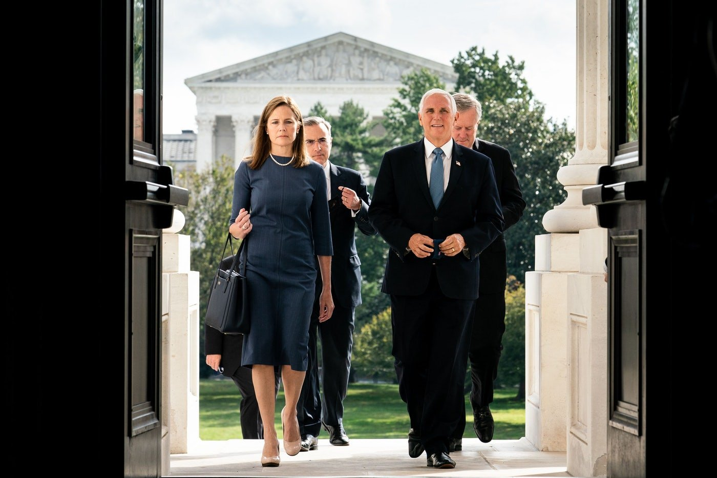 Judge Amy Coney Barrett, President Donald Trump's nominee to the Supreme Court and Vice President Mike Pence walk up the steps of the Capitol to meet with Senators in Washington, DC.