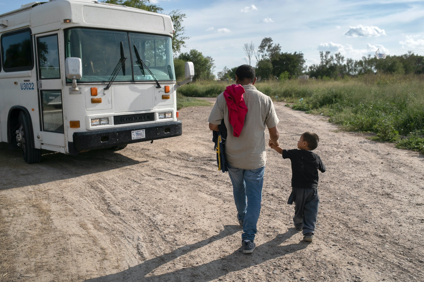 A 3 year old unaccompanied minor from Honduras waits to be bussed to a U.S. Border Patrol facility in Texas.