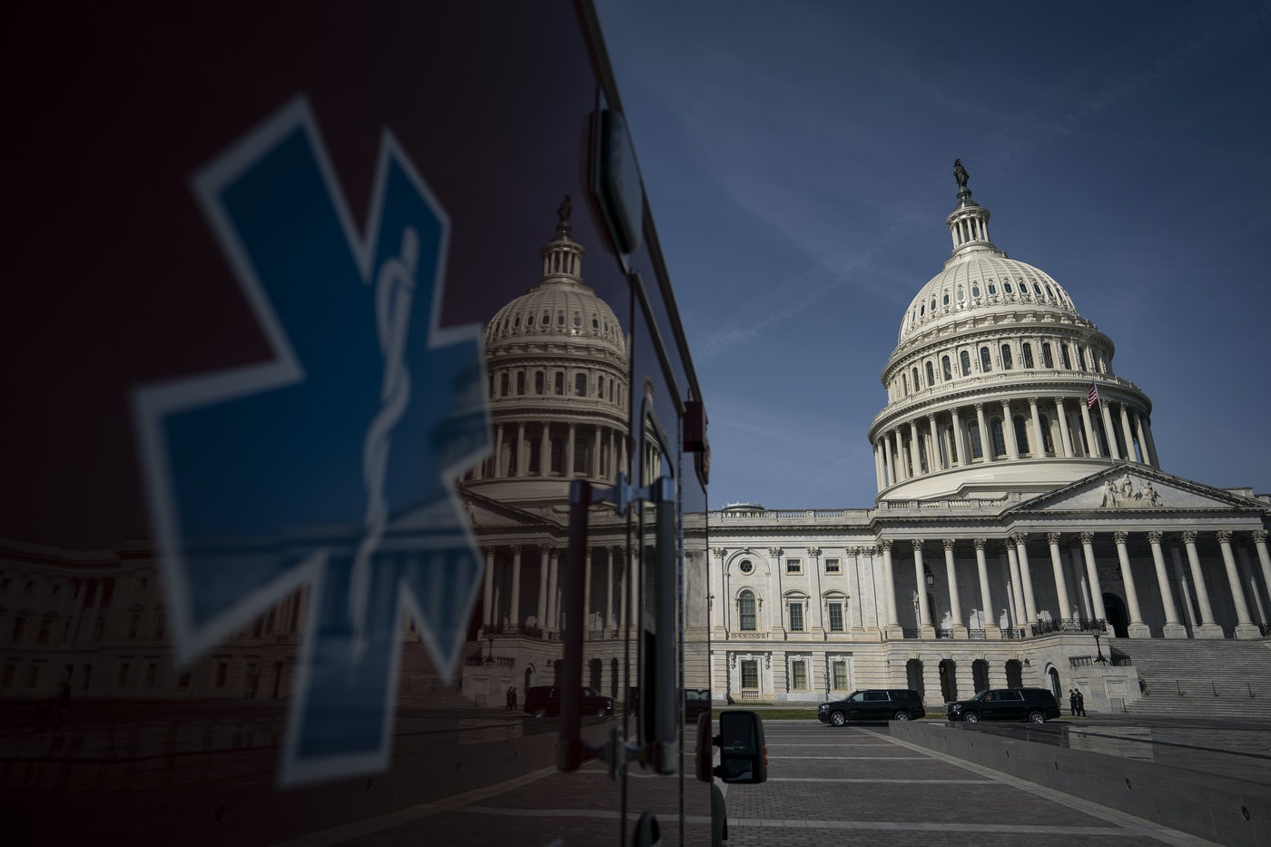 The U.S. Capitol is reflected on the side of an ambulance.