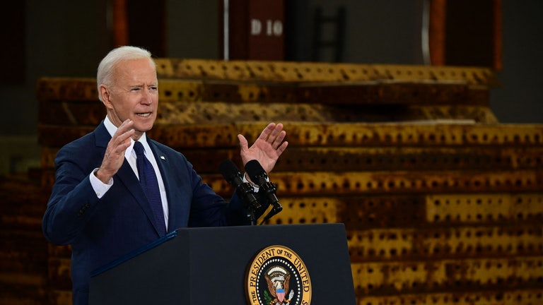 Joe Biden speaks at a podium.