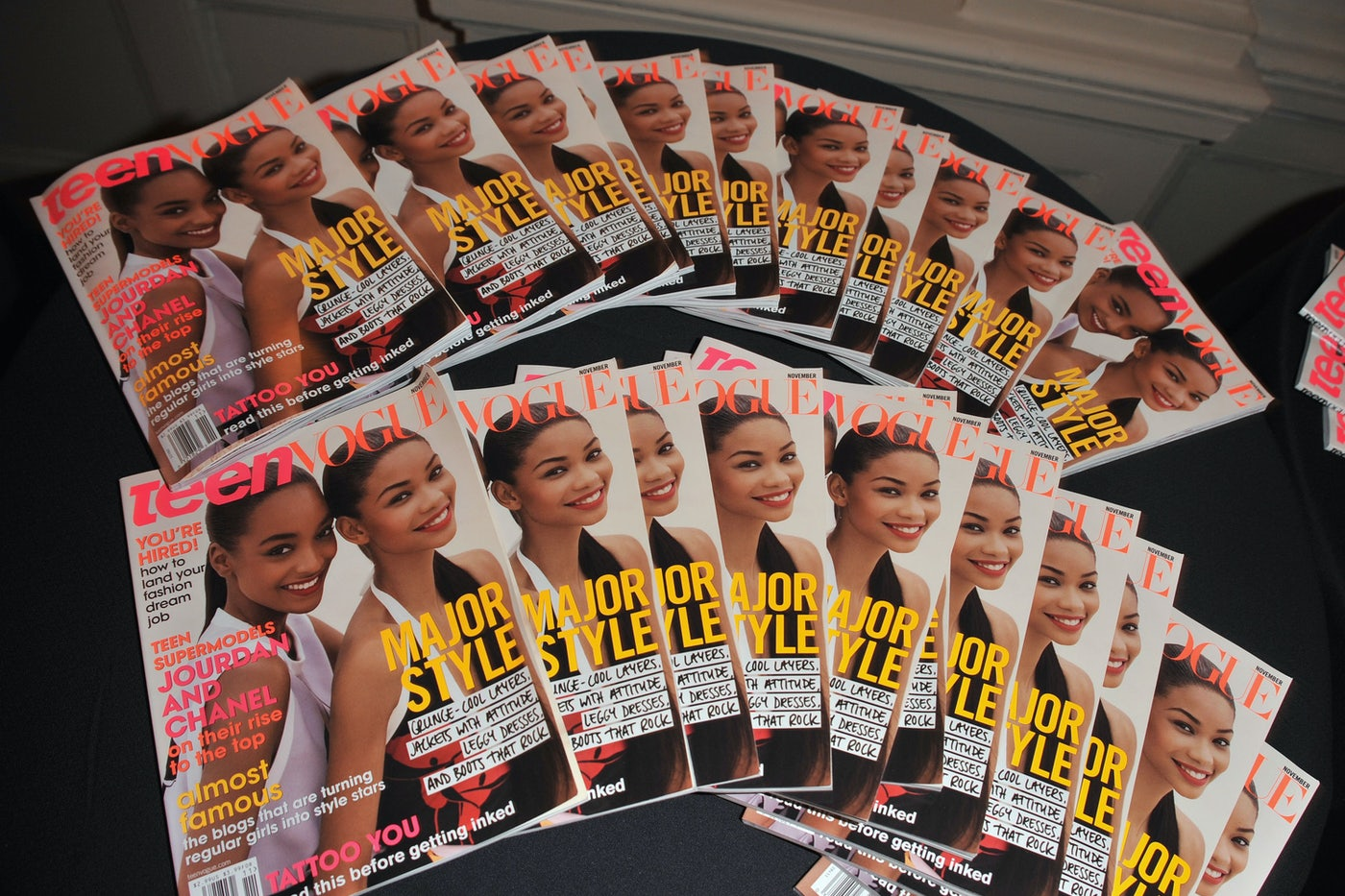 Copies of Teen Vogue magazine are displayed on a table