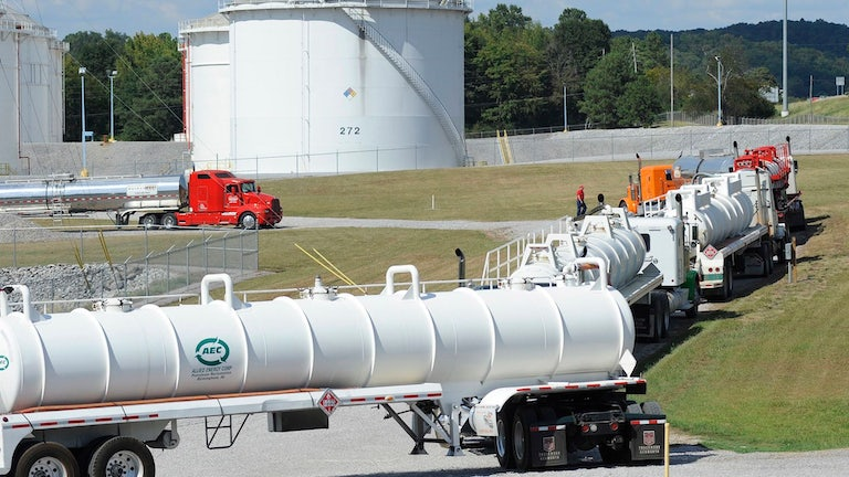 Tanker trucks line up at a Colonial Pipeline facility.