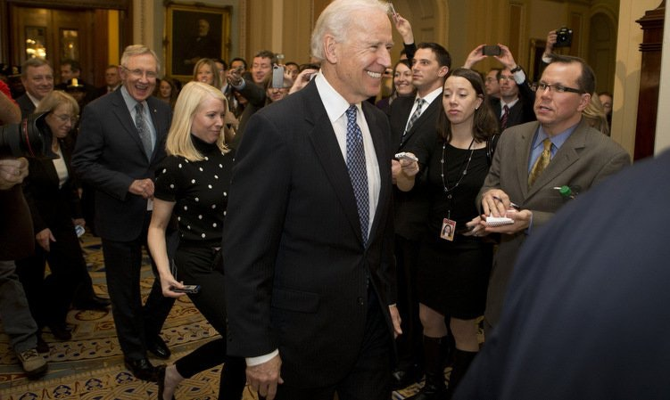 Vice President Joe Biden arrives at a Democratic caucus meeting, merriment in tow. (Andrew Harrer/Bloomberg/Getty Images)