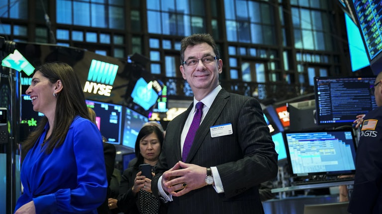 Albert Bourla, chief executive officer of Pfizer pharmaceutical company, arrives to ring the closing bell at the New York Stock Exchange in January 2019.