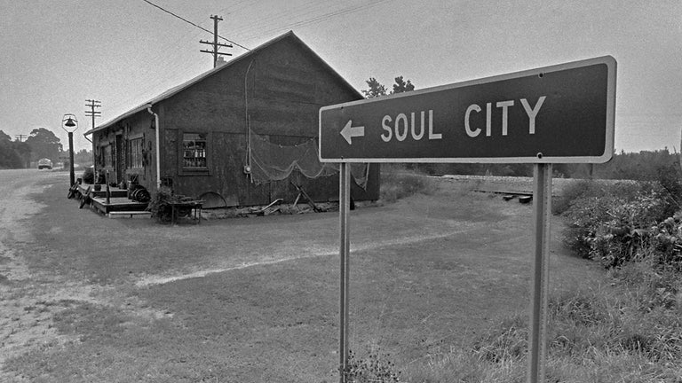 A highway sign for Soul City on Route 1.