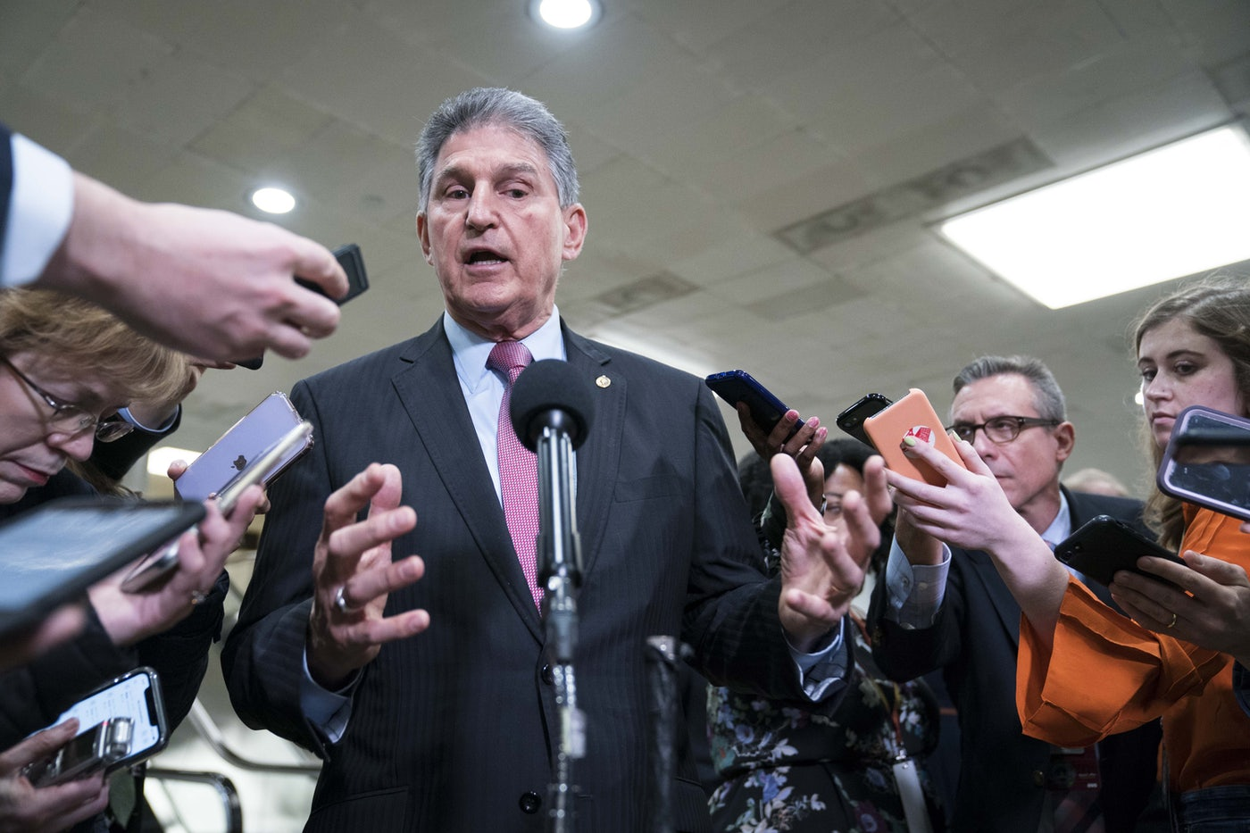 West Virginia Senator Joe Manchin speaks to reporters at the U.S. Capitol