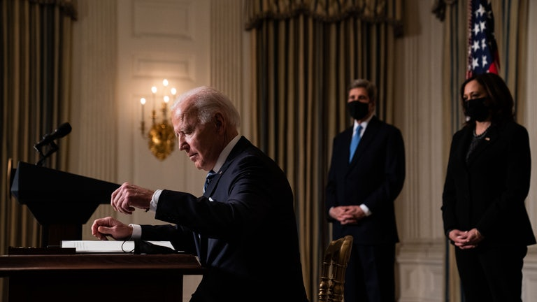 Joe Biden prepares to sign executive orders relating to climate change issues on January 27.