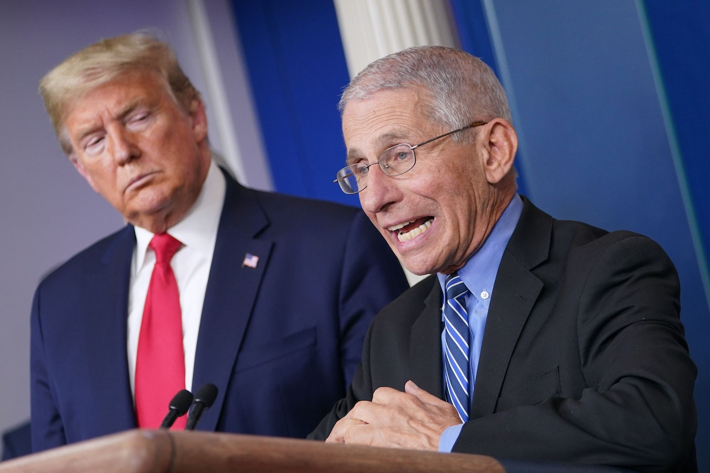 President Trump watches Dr. Anthony Fauci during a briefing on coronavirus.