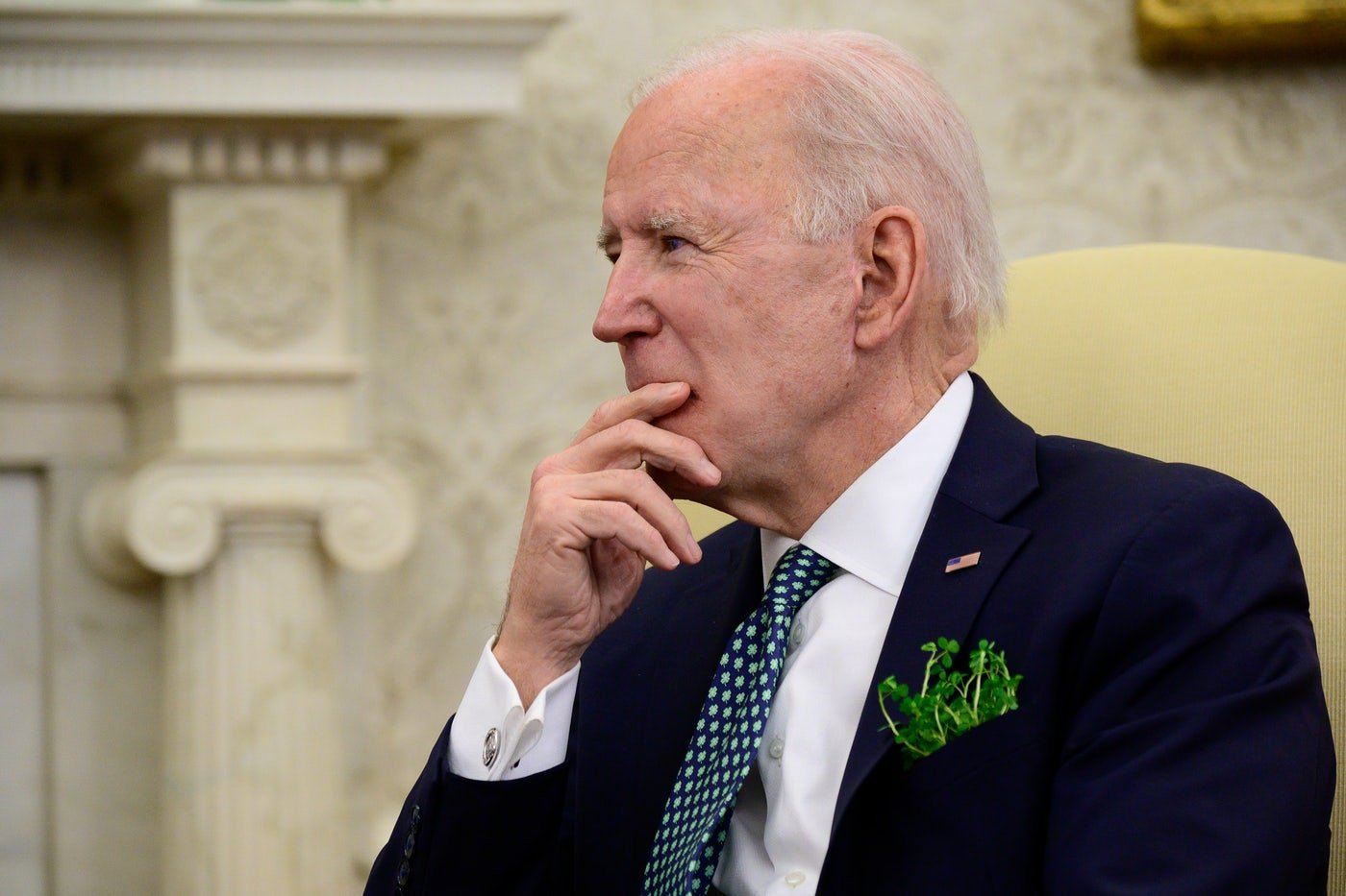 Joe Biden listens during a conference call in the Oval Office.