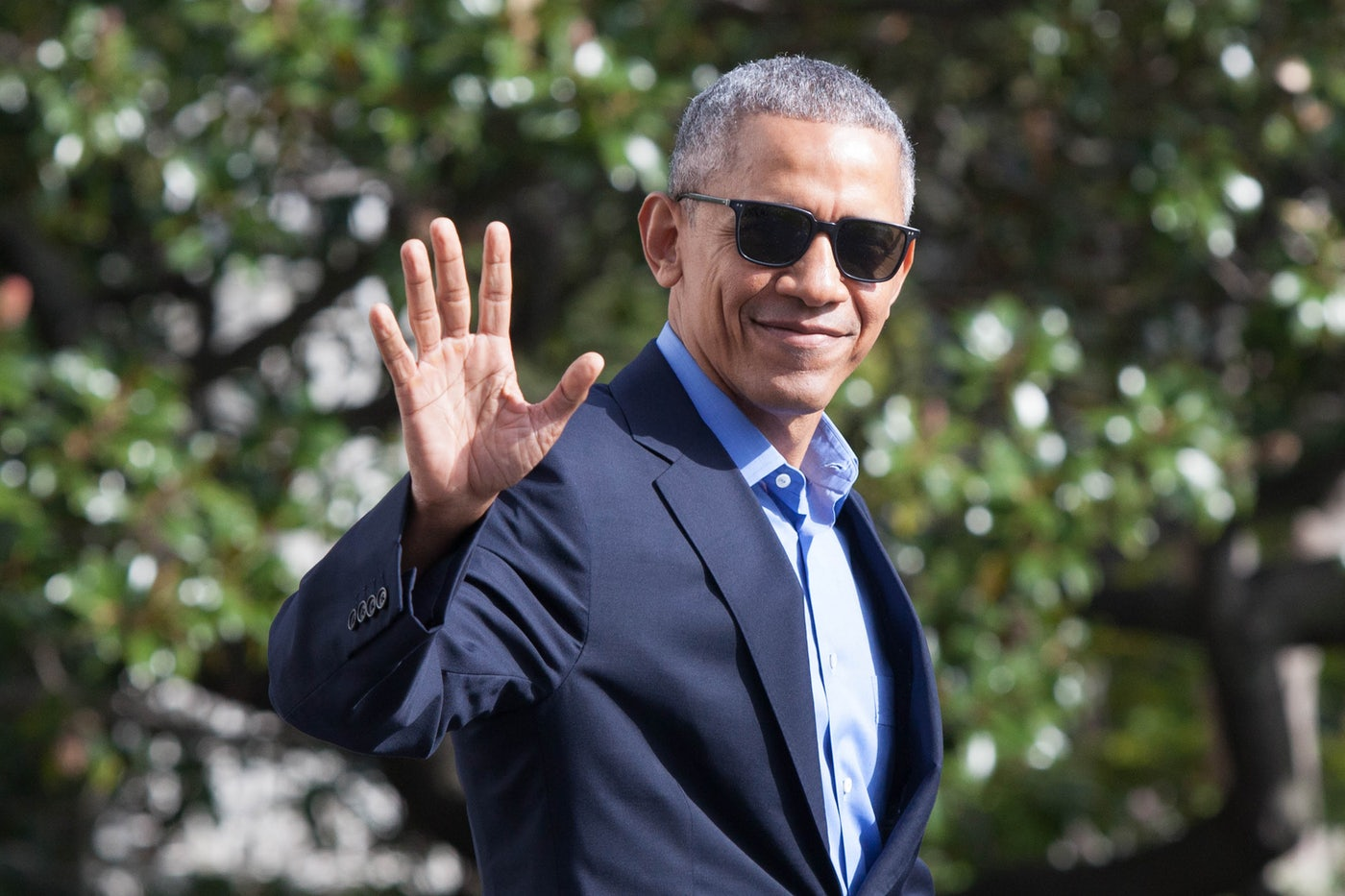 Former President Barack Obama waves.