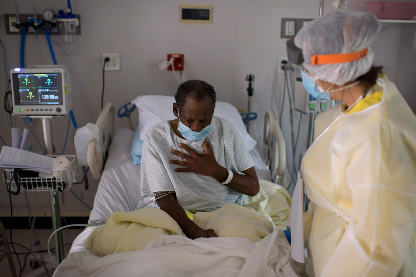 A health care worker tends to a Covid-19 patient in Houston.