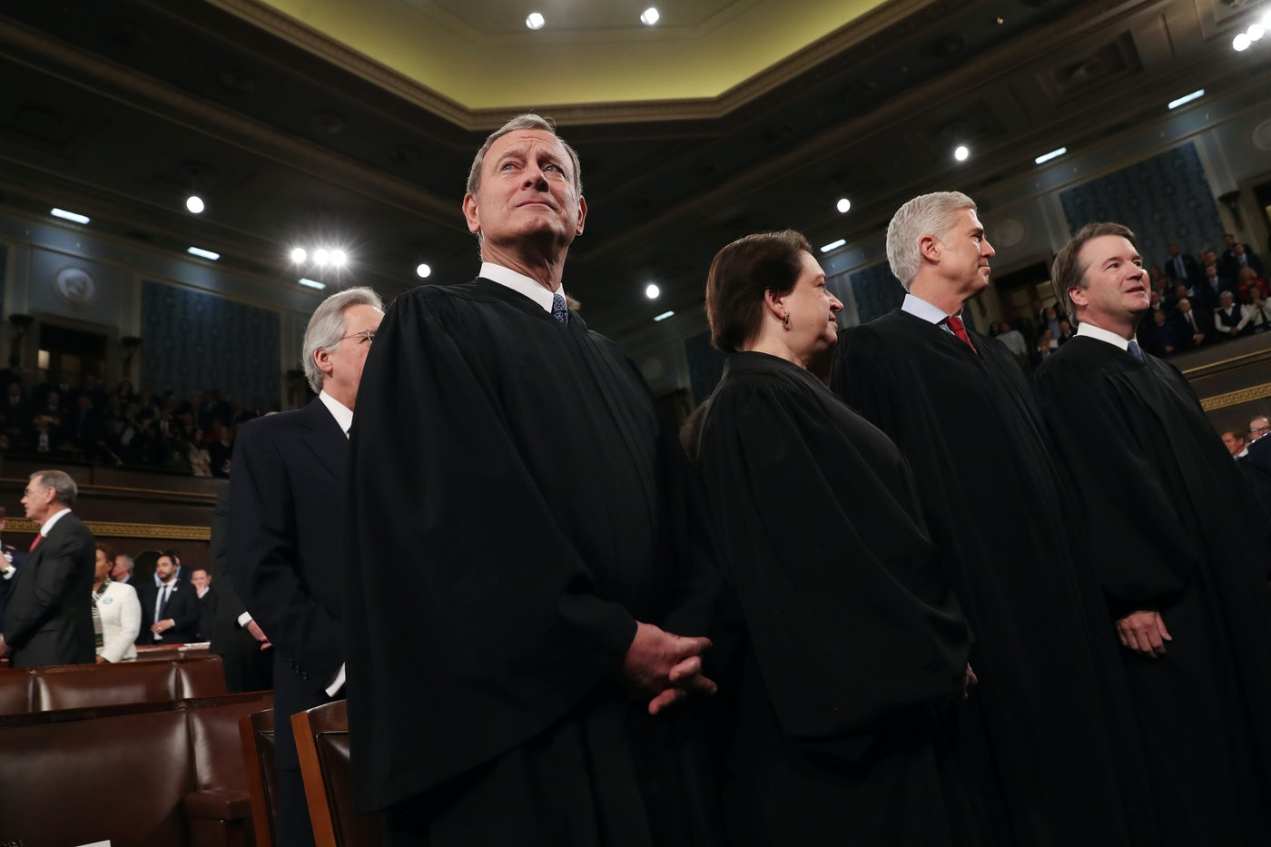 Chief Justice John Roberts waits to hear President Donald Trump deliver the State of the Union address.
