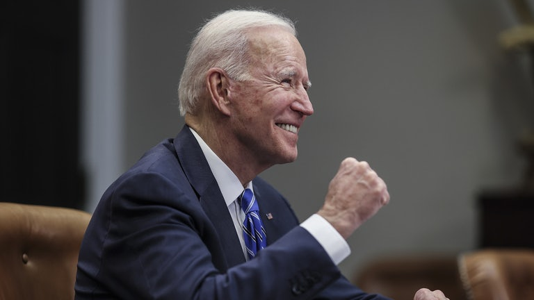 President Joe Biden celebrates with a fist pump at the White House.