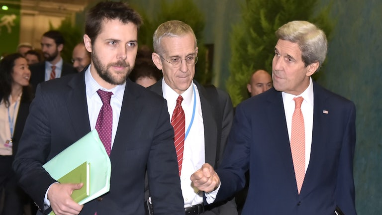 Brian Deese walks with then-Secretary of State John Kerry in 2015.
