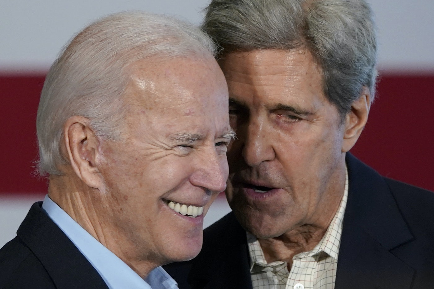 John Kerry speaks to Joe Biden.