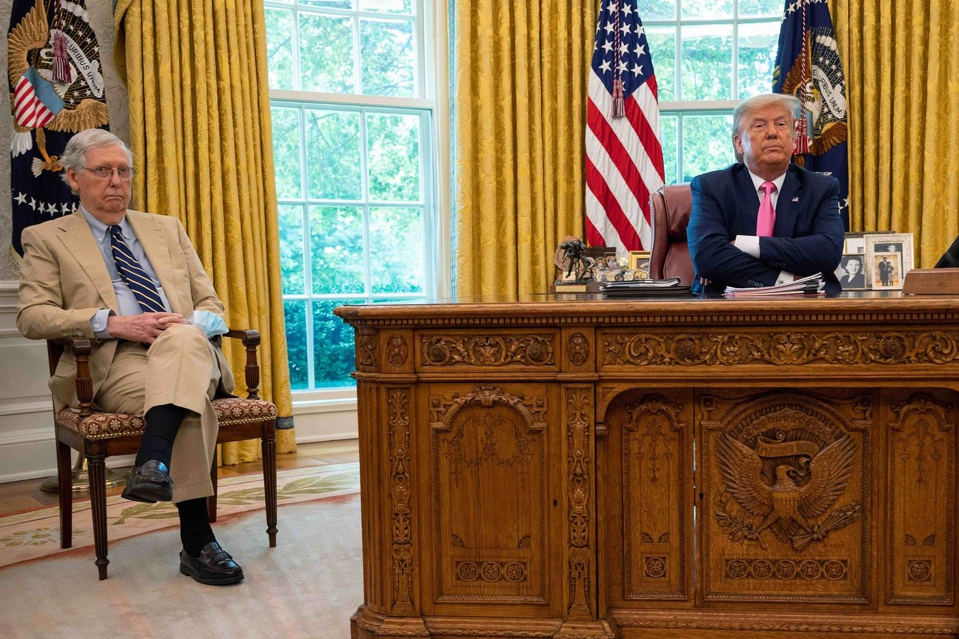 President Donald Trump speaks with Senate Majority Leader Mitch McConnell in the Oval Office.