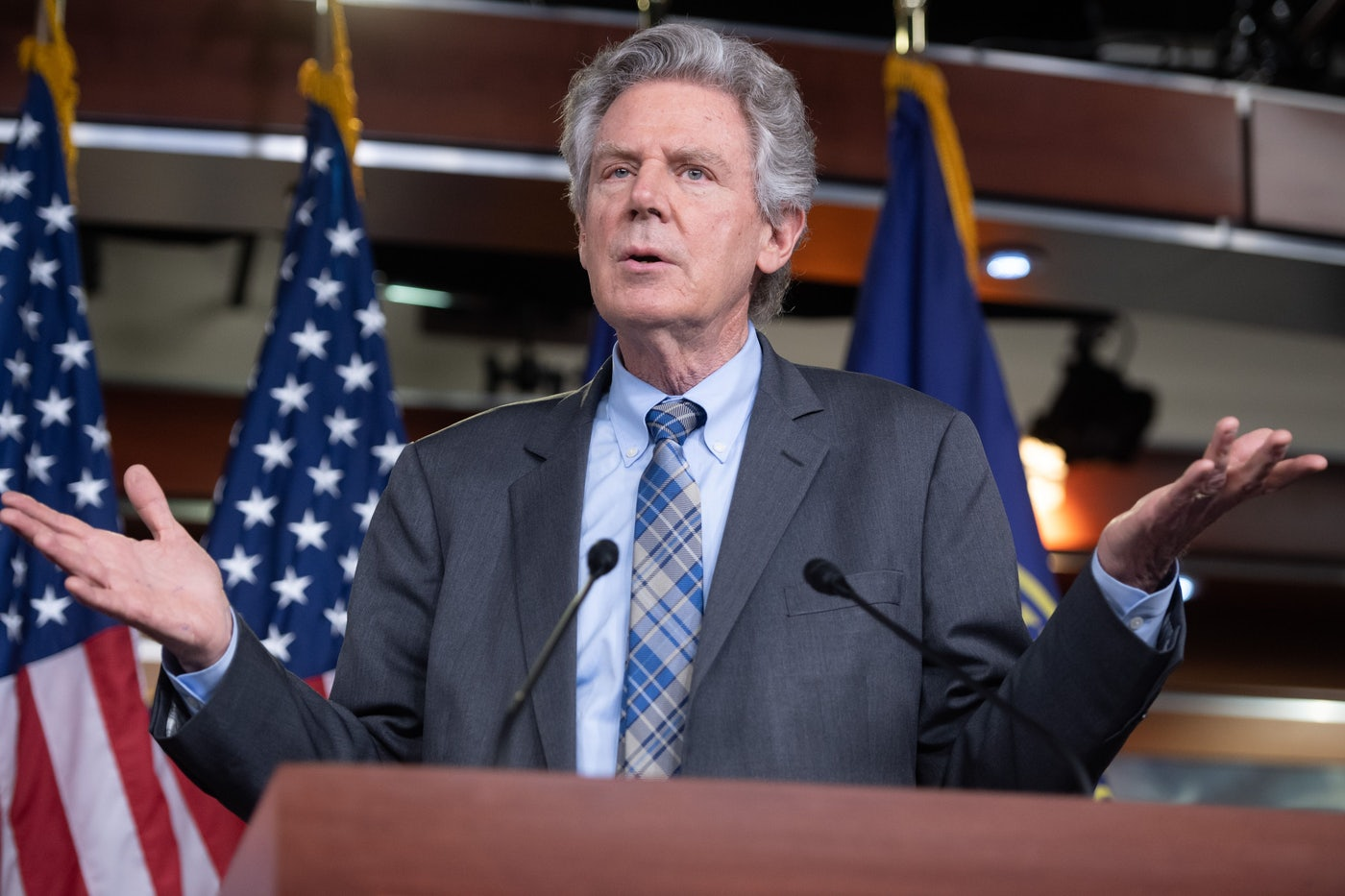 Frank Pallone gesticulates at a press conference.