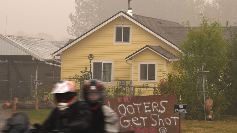 """Looters Get Shot"" outside an Oregon house evacuated due to wildfires."