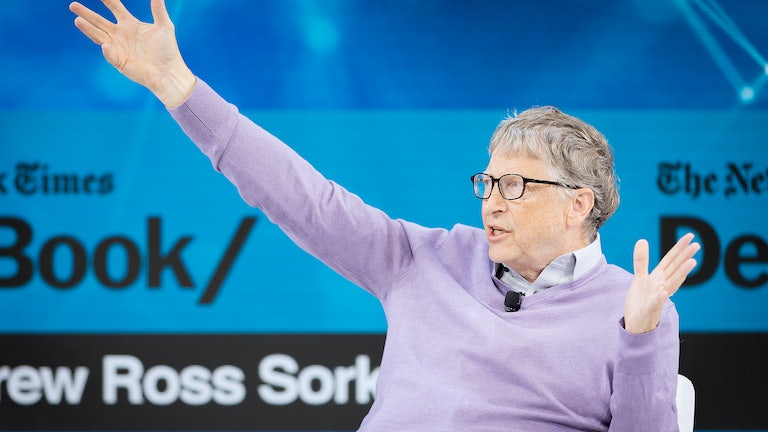 Bill Gates gestures while speaking.