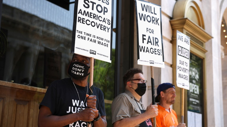 """Activists with One Fair Wage participate in a """"Wage Strike"""" demonstration outside of the Old Ebbitt Grill in Washington DC."""