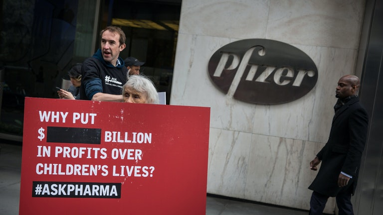 Protesters picket outside Pfizer's Manhattan office, demanding equitable global access to vaccines.