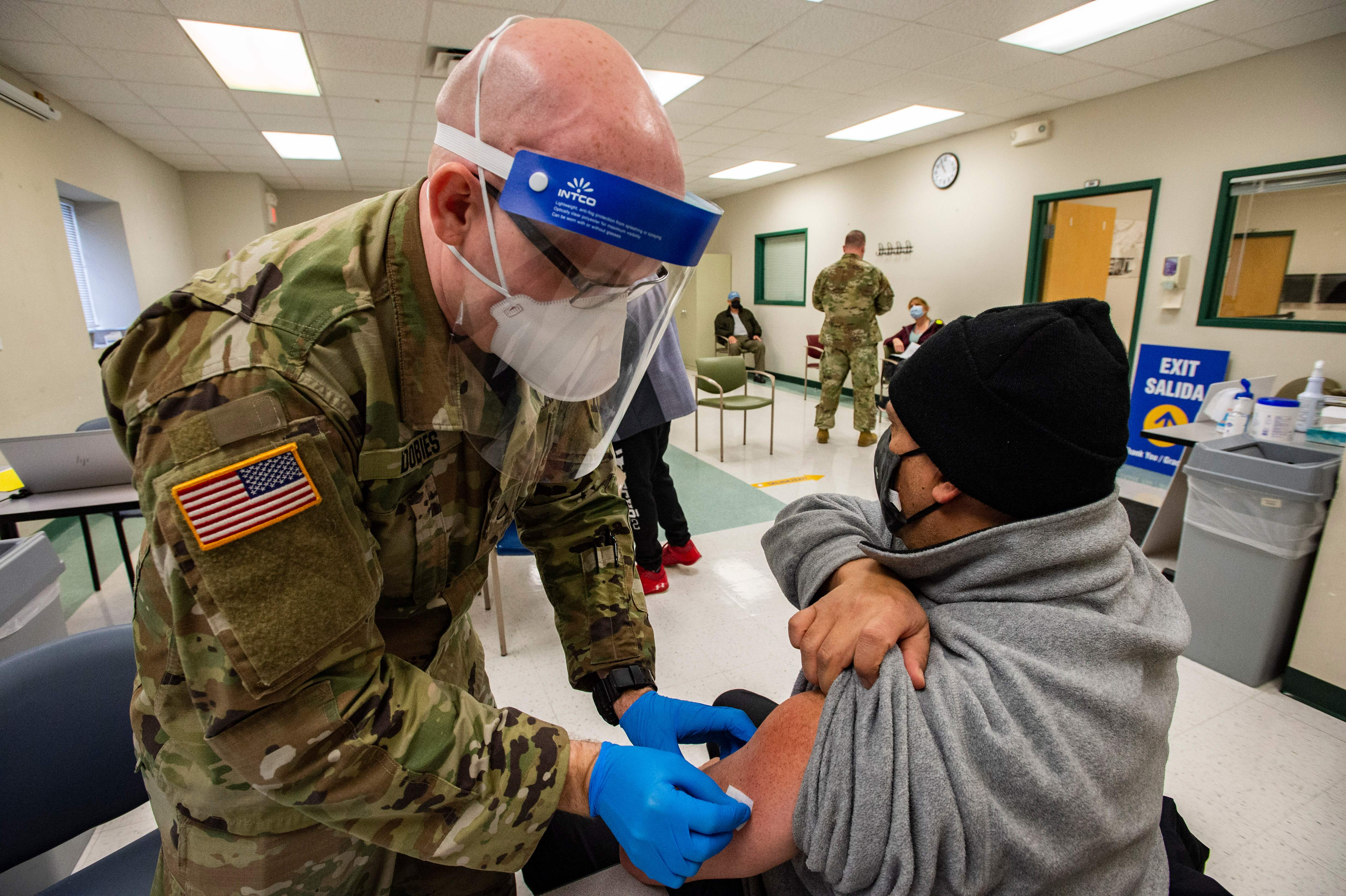 Why Are Troops Leading the Vaccination Effort? thumbnail