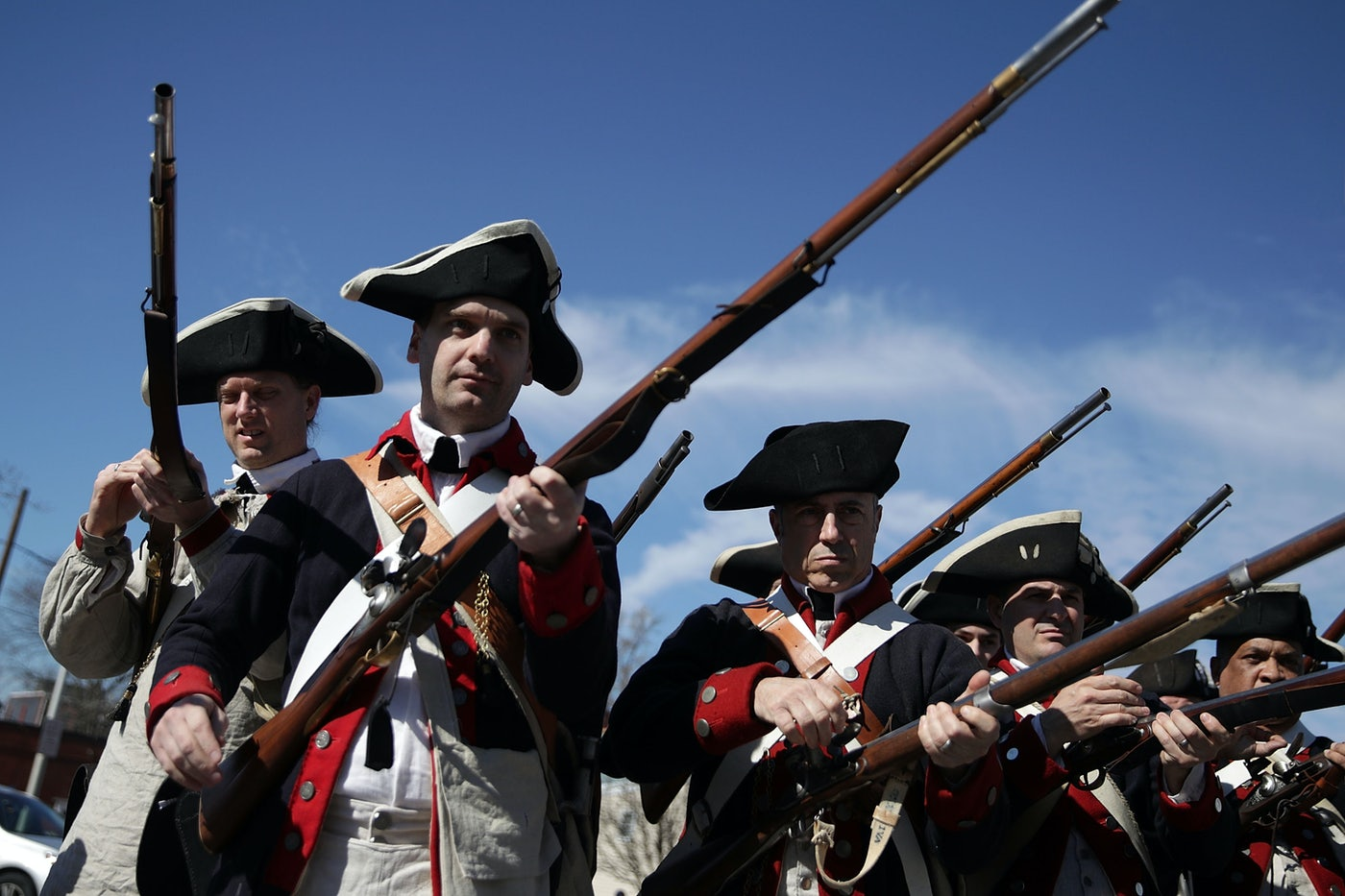 Members of the First Virginia Regiment, a Revolutionary War living history reenactment group, participate in the annual George Washington Birthday Parade in Virginia.
