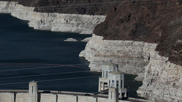 Low water levels are seen at Lake Mead, indicated by bleached rock where water once was.