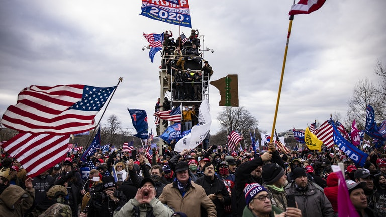 Pro-Trump supporters scale scaffolding and storm the Capitol.