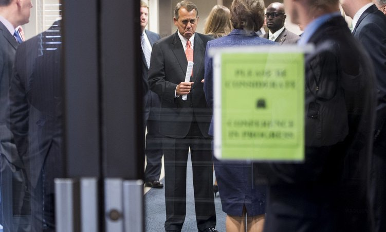 House Speaker John Boehner miraculously photobombs himself. (Bill Clark/Roll Call/Getty Images)