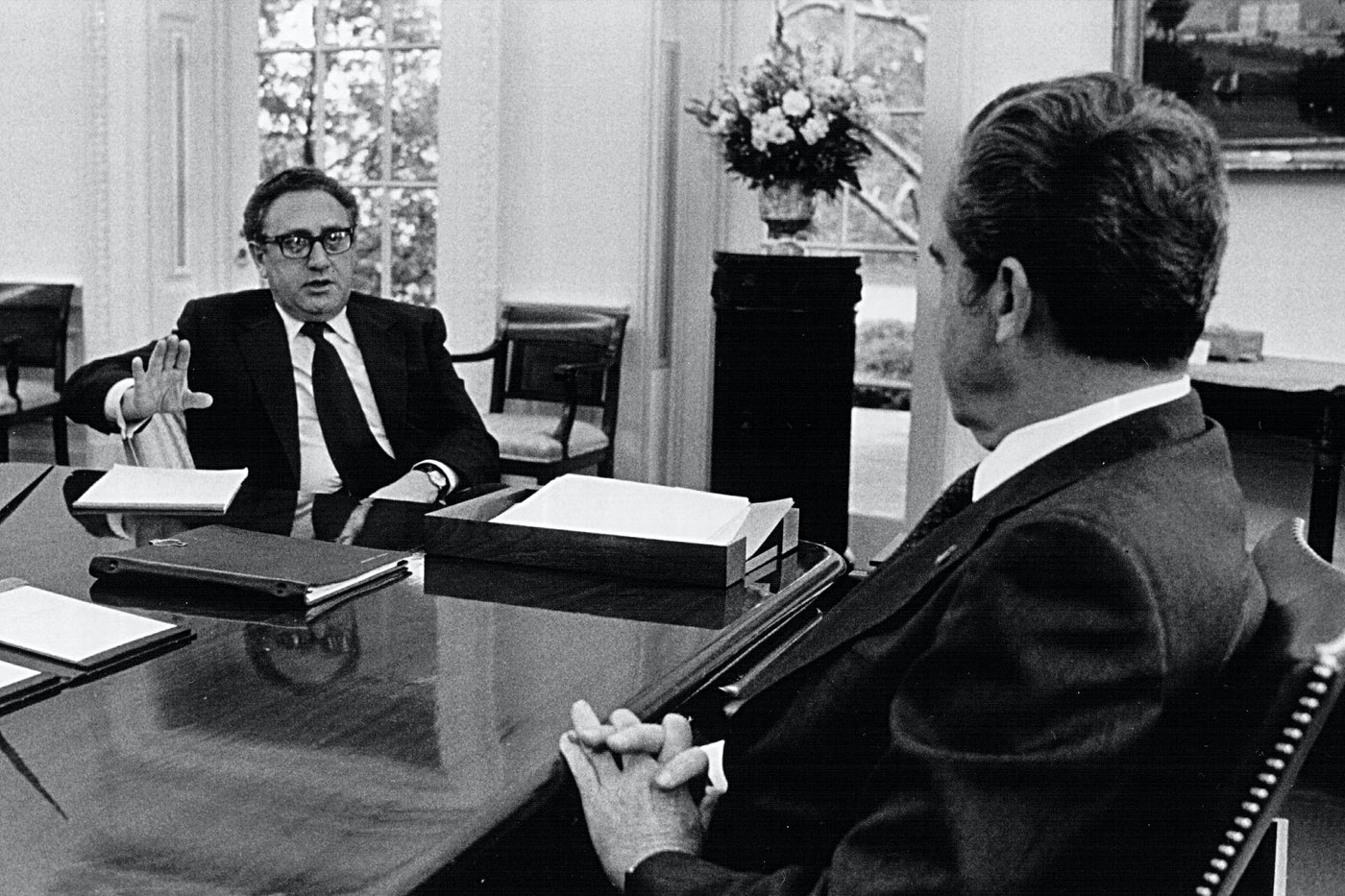 Henry Kissinger meets with Richard Nixon in 1974 at the White House.