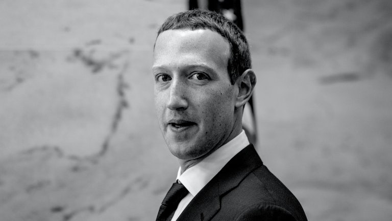 A black-and-white photograph of Facebook CEO Mark Zuckerberg