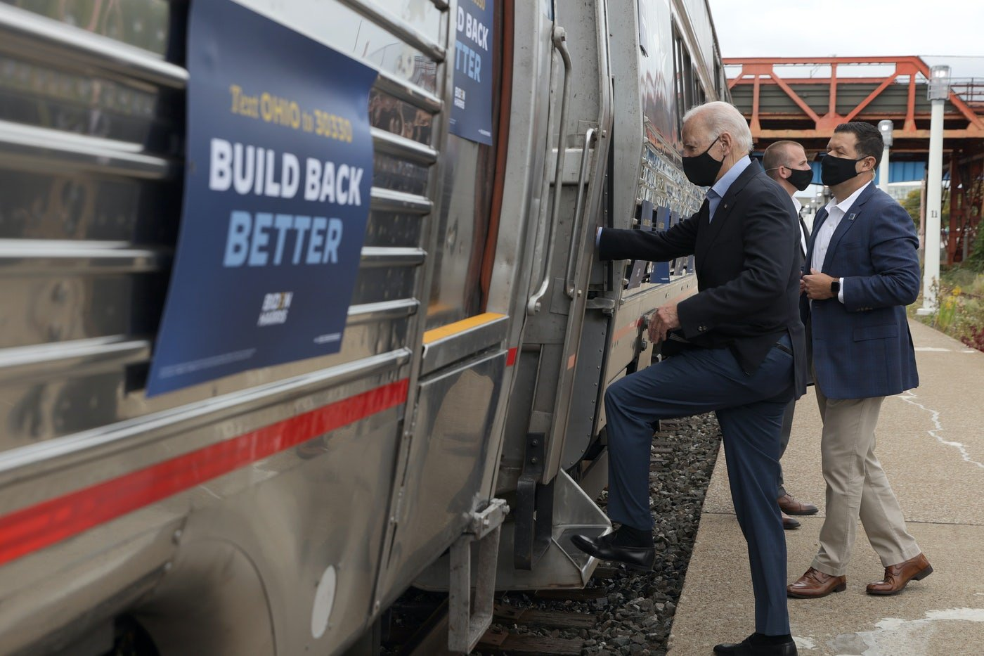 "Joe Biden gets on an Amtrak train sporting his ""Build Back Better"" campaign slogan."
