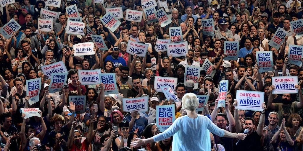 Image result for Elizabeth Warren attacks corporate greed in front of biggest crowd yet