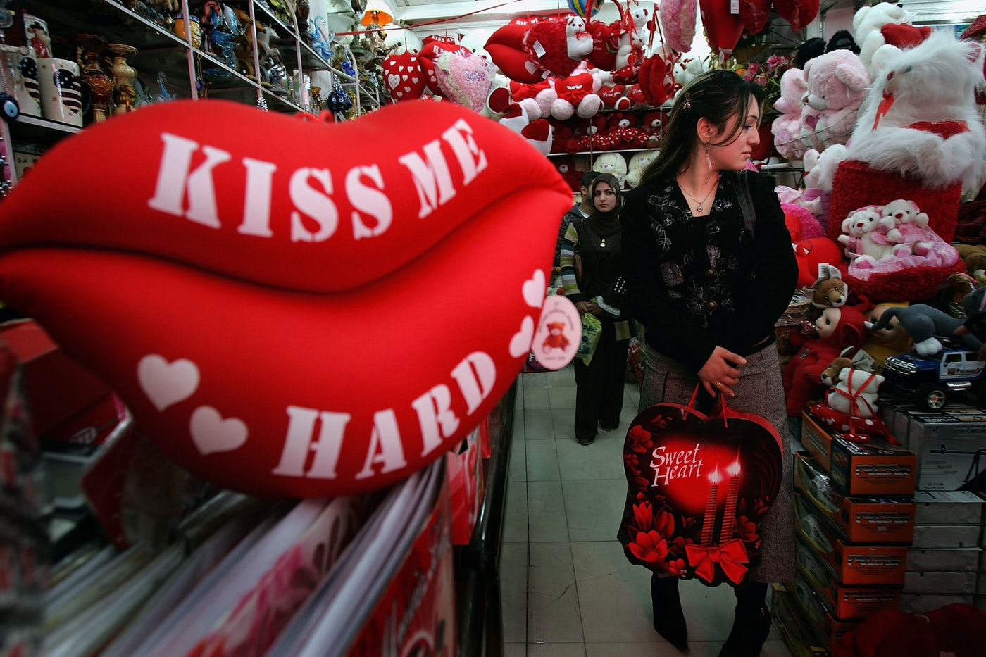 A woman shops a Valentine's Day display.