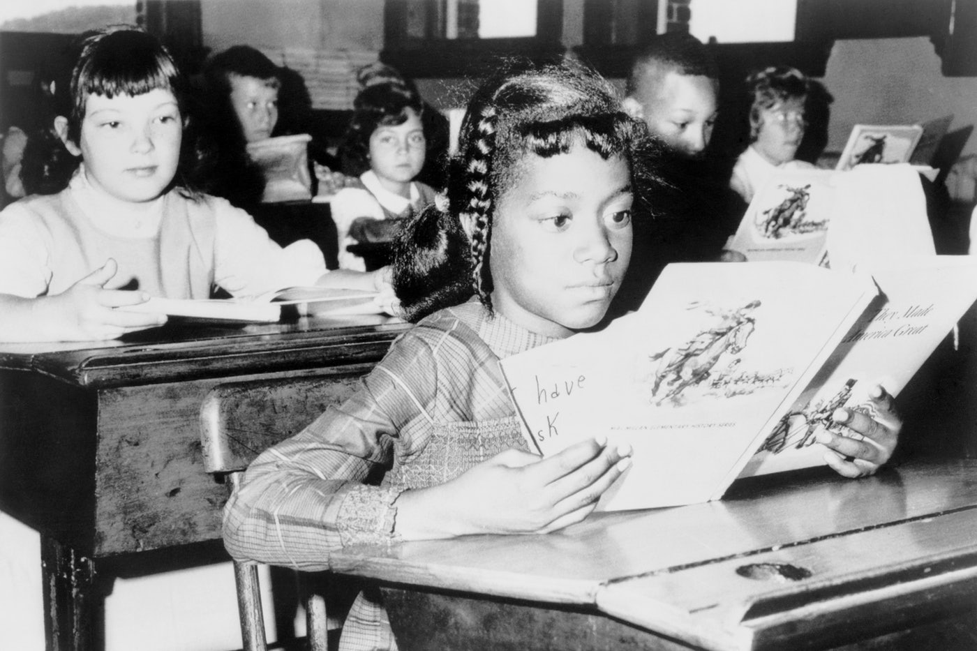 "A child from Roxbury, in Boston, attending school as part of the desegregation effort ""Operation Exodus"" in 1965."