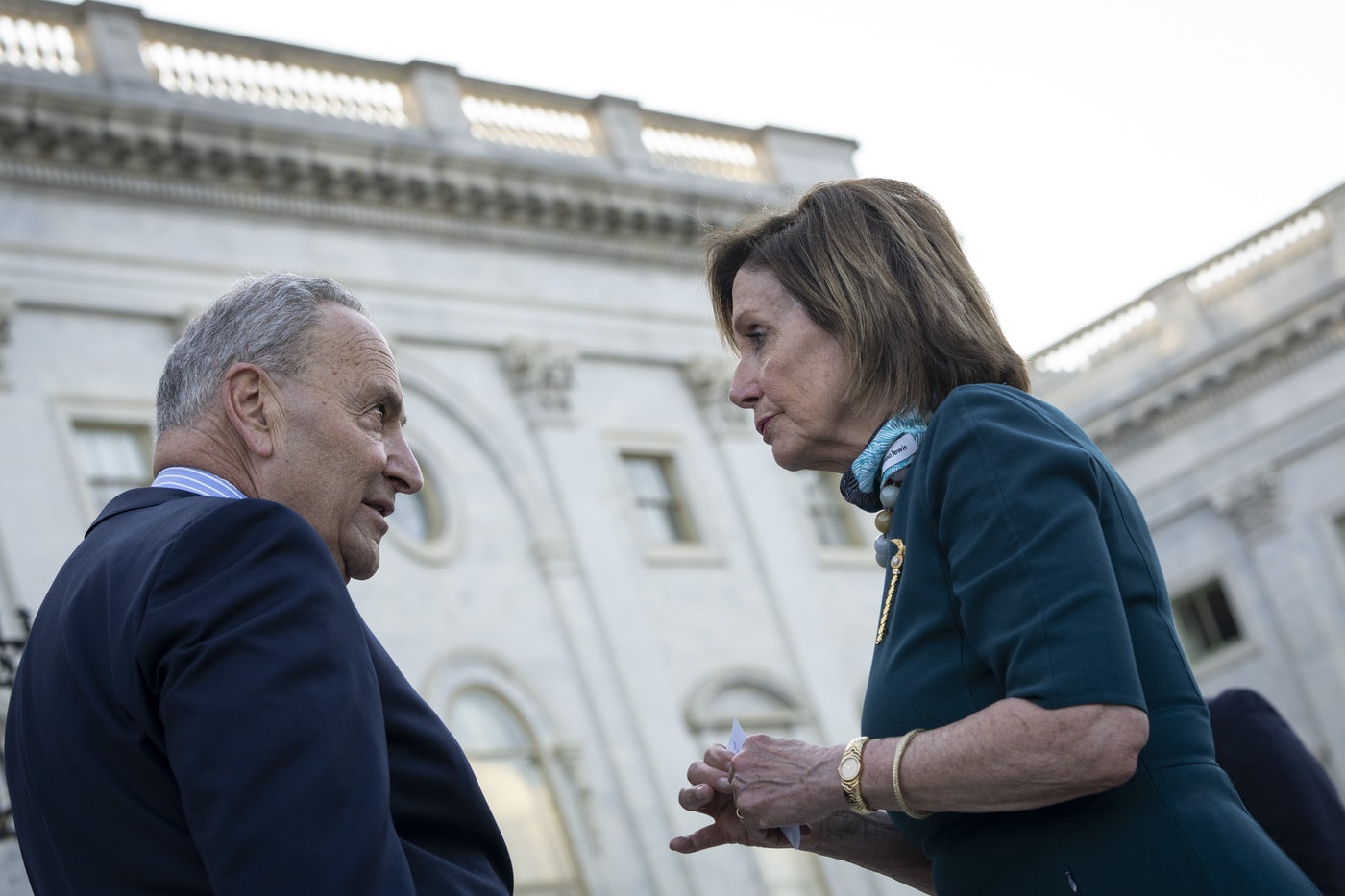 Chuck Schumer and Nancy Pelosi have a heated discussion on the steps of the U.S. Capitol.