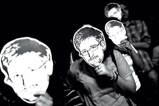 Edward Snowden supporters in masks