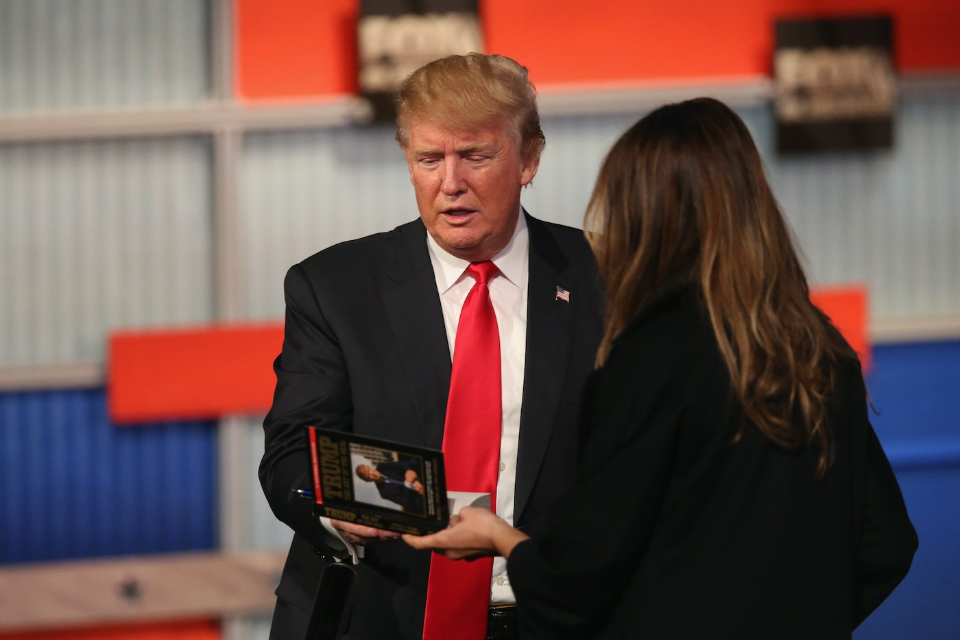 Trump holds a book