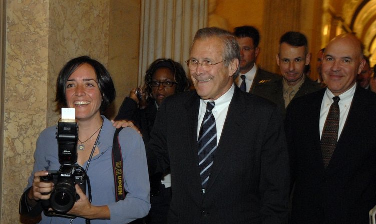 A masterful photobomb is carried out behind Donald Rumsfeld's right shoulder. (Tom Williams)