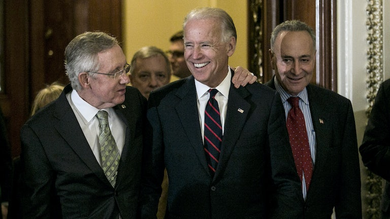Senators Harry Reid and Chuck Schumer leave the Senate chamber with a beaming Vice President Biden in 2012