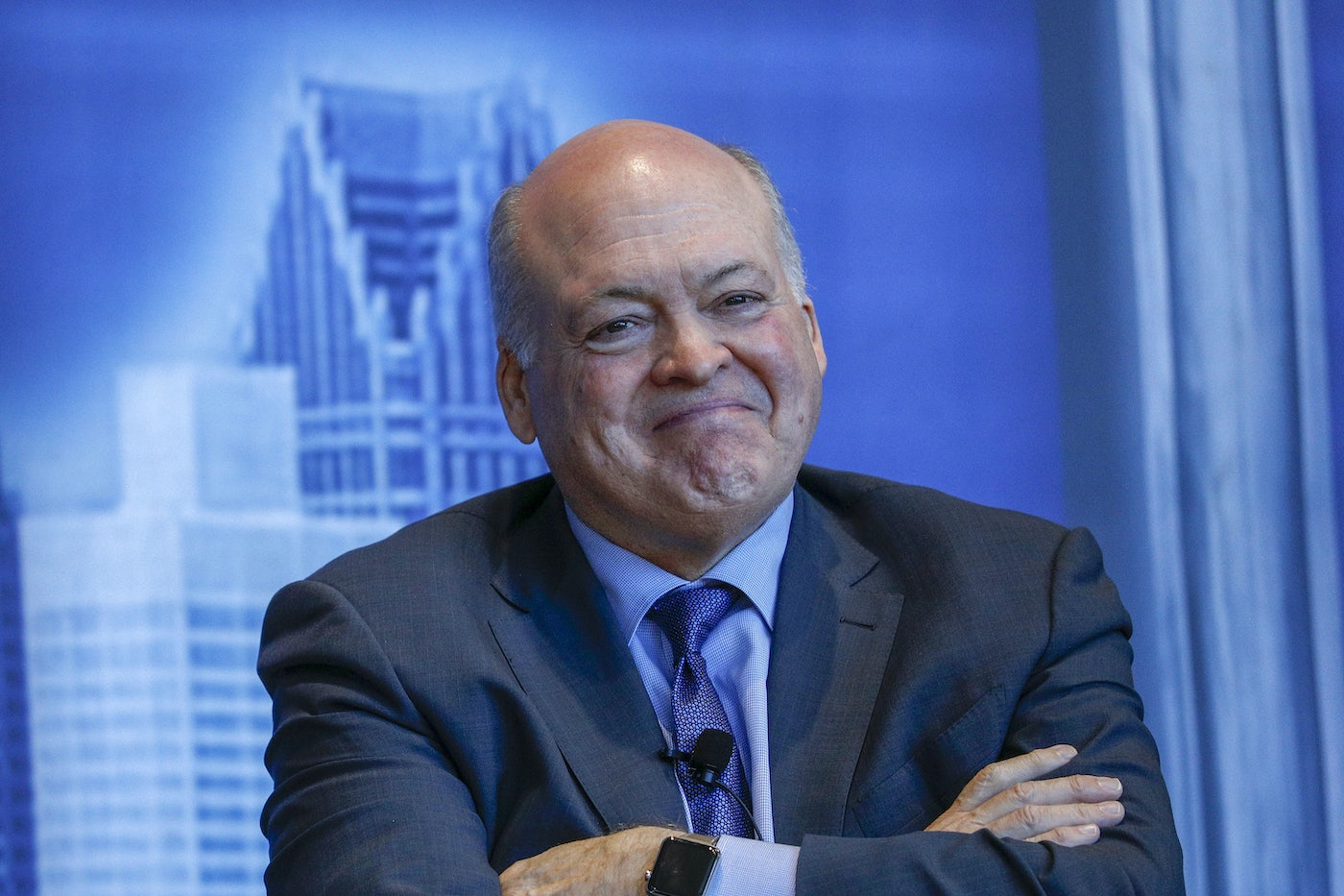 Former Ford CEO Jim Hackett sports a smile in 2019.
